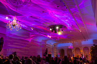 This photo shows two of our laser lumia systems washing a ceiling for a fundraising gala at a historical museum.