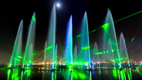 A long-term exposure image late into the wee hours of the morning during a video shoot of IMAGINE-Dubai Festival City. The stilness of the water and the moonlight allowed us to see the form of the water assets and captured a moment in time. The green hue from the lasers in the finale scene.